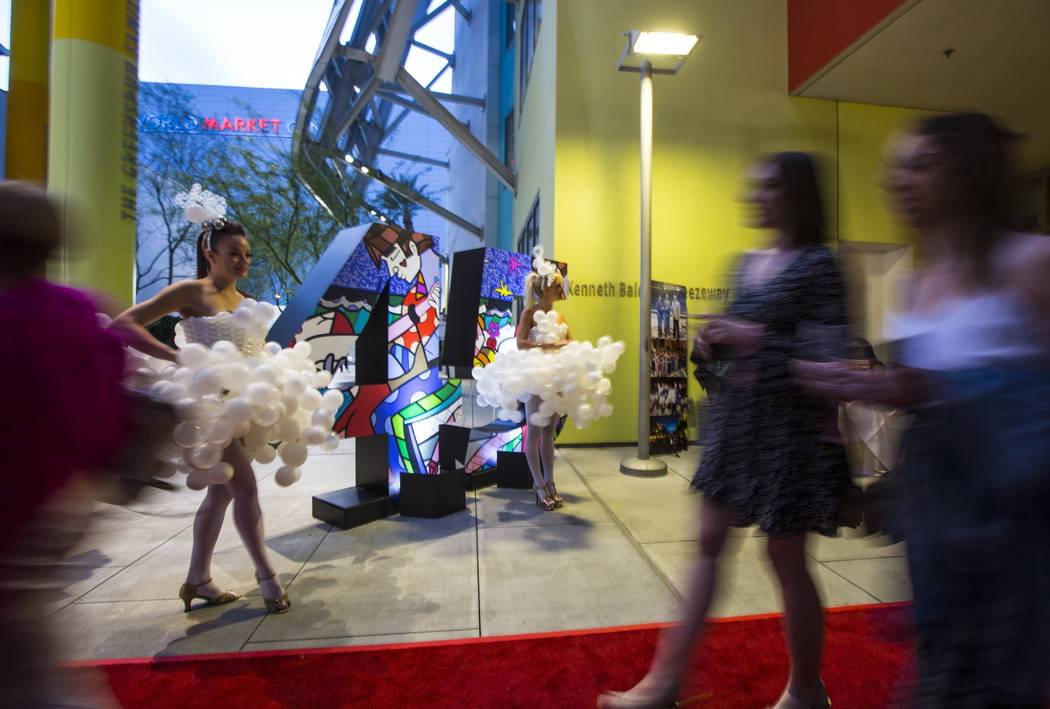 Michelle Bell, left, and Lucie May model dresses by balloon artist Ronnie Johnson during Bubble ...