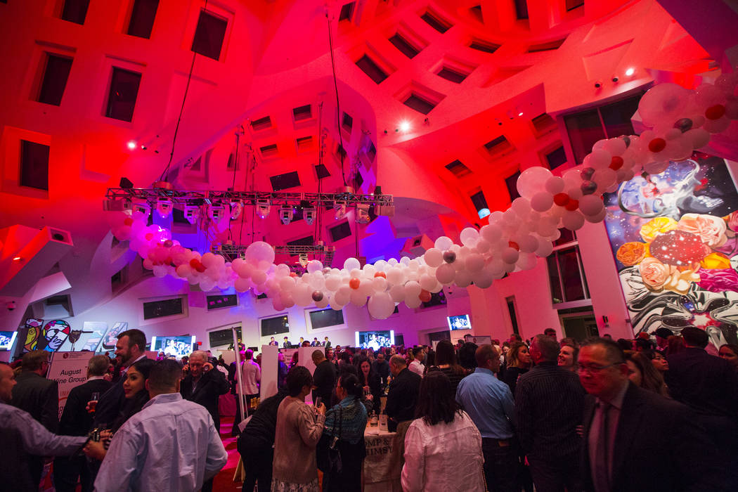 Attendees roam during Bubble-Licious, the UNLVino kickoff event, at the Keep Memory Alive Event ...