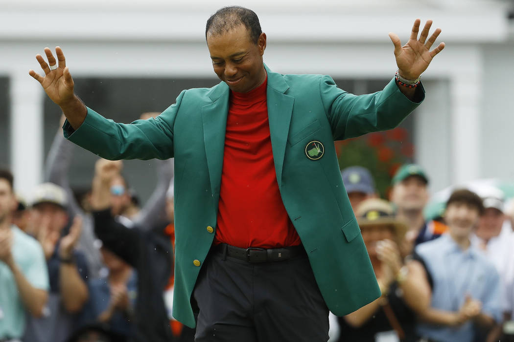 Tiger Woods smiles as he wears his green jacket after winning the Masters golf tournament Sunda ...