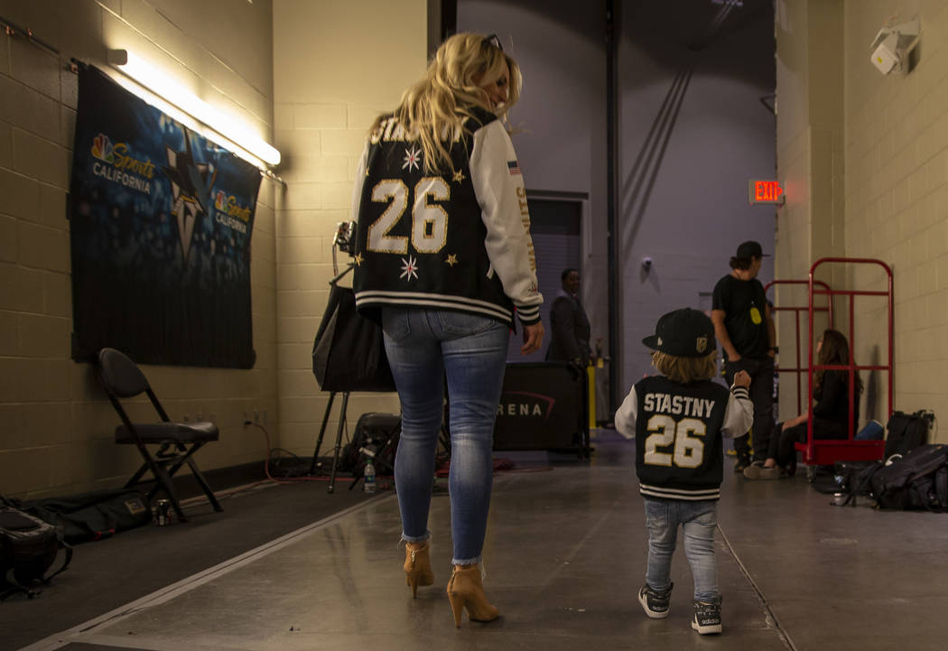 Haley Stastny and Draper,2, make their way outside the arena before the start of Game 3 of an N ...