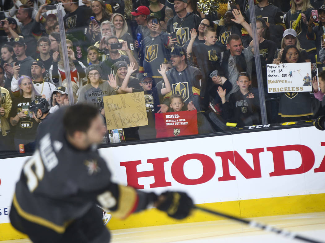 Golden Knights fans watch as players warm up before Game 3 of an NHL Western Conference quarter ...