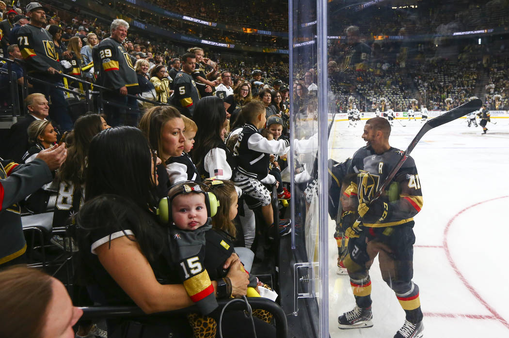 Golden Knights center Pierre-Edouard Bellemare (41) visits with family and friends while warmin ...