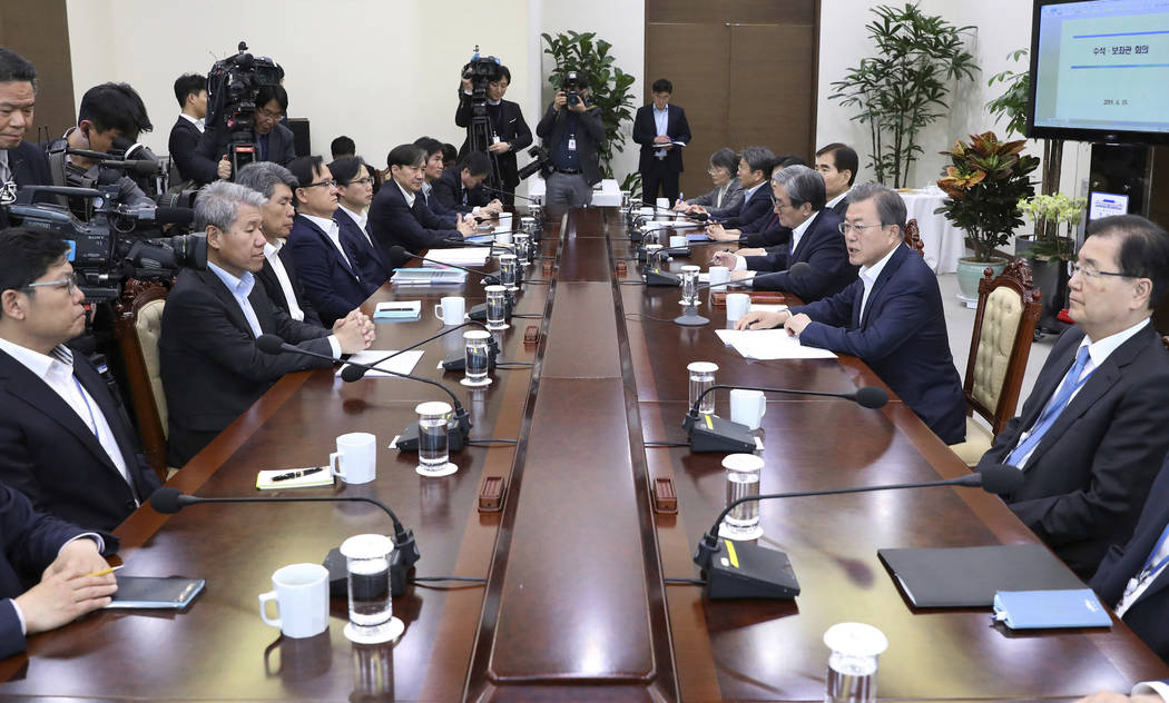 South Korean President Moon Jae-in, second from right, speaks during a meeting with his aids at ...