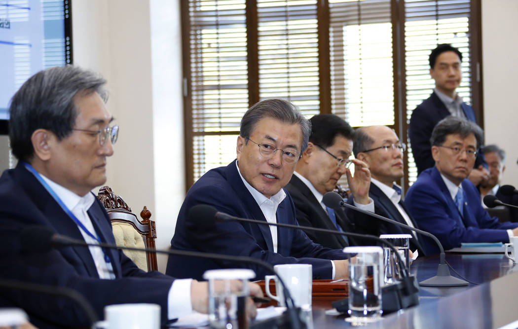 South Korean President Moon Jae-in, second from left, speaks during a meeting with his aids at ...