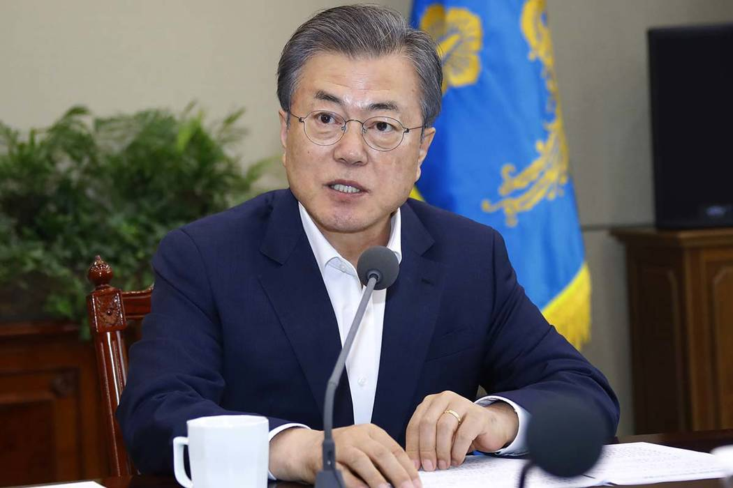 South Korean President Moon Jae-in speaks during a meeting with his aids at the presidential Bl ...