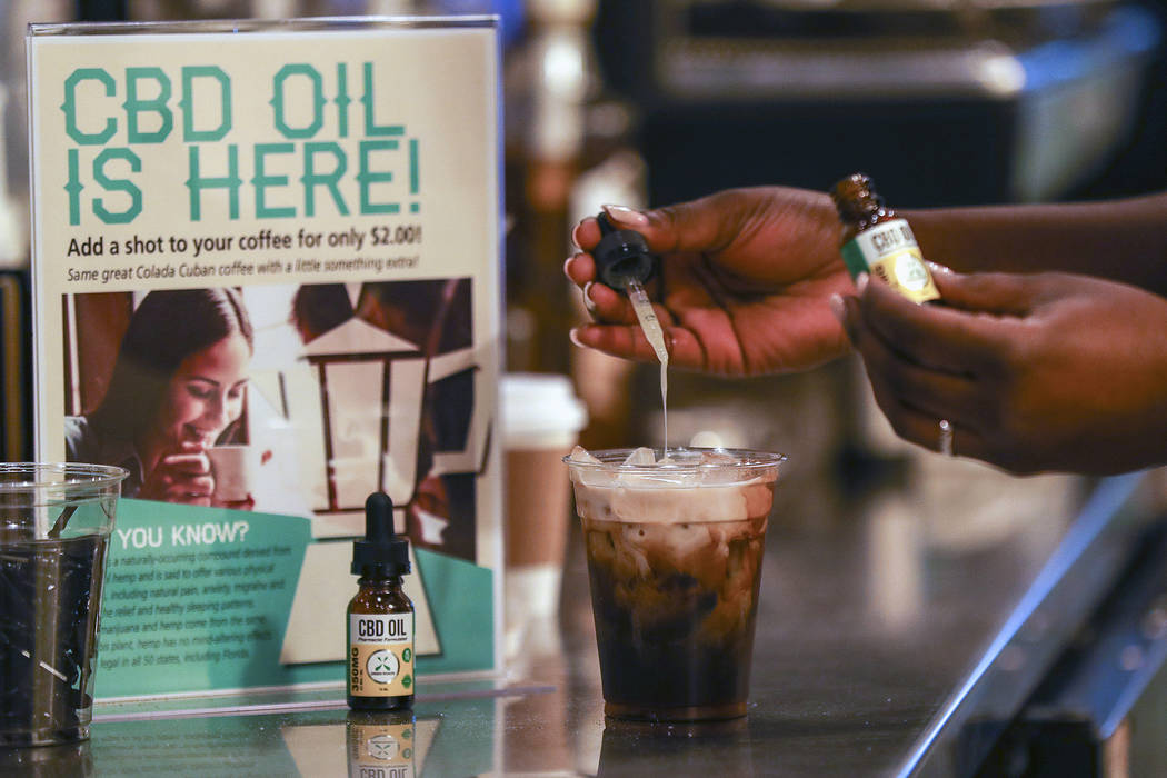A worker adds cannabidiol (CBD) to a drink at a coffee shop in Fort Lauderdale, Fla. on Jan. 4, ...
