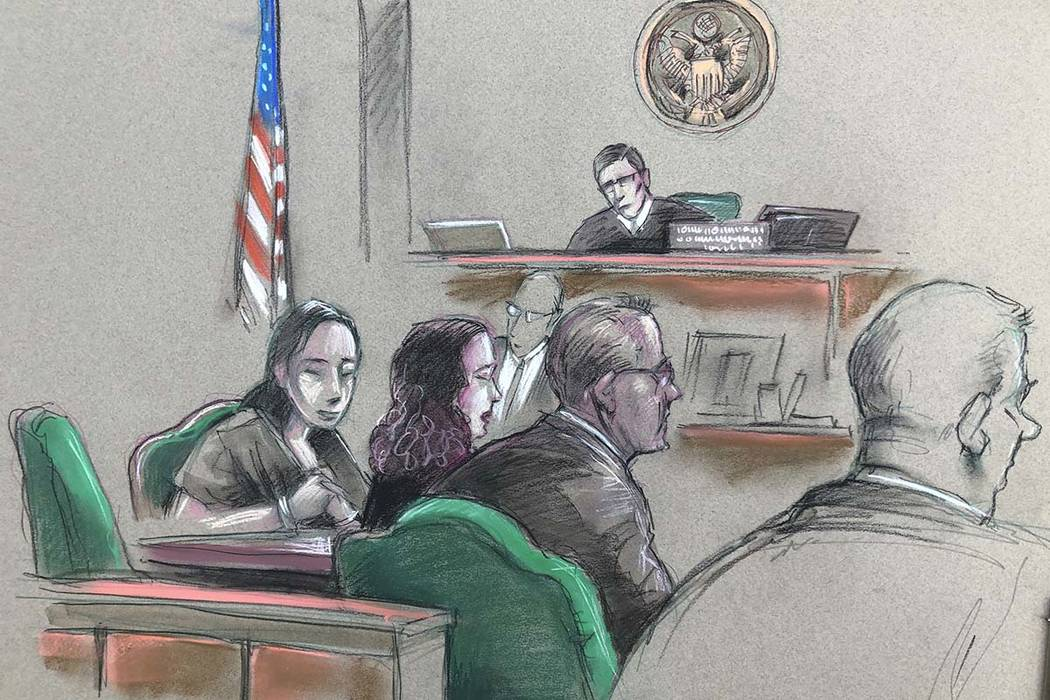 In this artist sketch, a Chinese woman, Yujing Zhang, left, listens to a hearing Monday, April ...