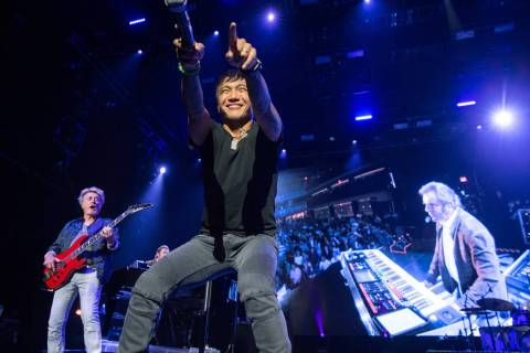 Ross Valory, Arnel Pineda and Jonathan Cain of Journey are shown during the band's opening nigh ...