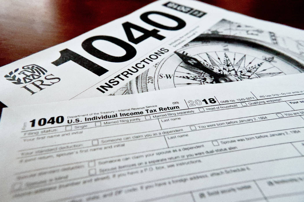 This Feb. 13, 2019, file photo shows multiple forms printed from the Internal Revenue Service w ...