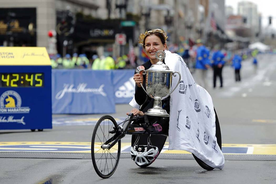 Manuela Schar, of Switzerland, poses with the trophy after winning the women's handcycle divisi ...