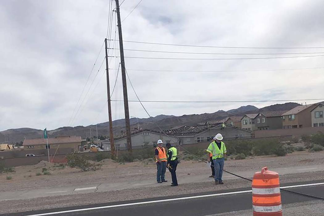 A downed power line on Boulder Highway near Wagonwheel Drive in Henderson has closed the road u ...