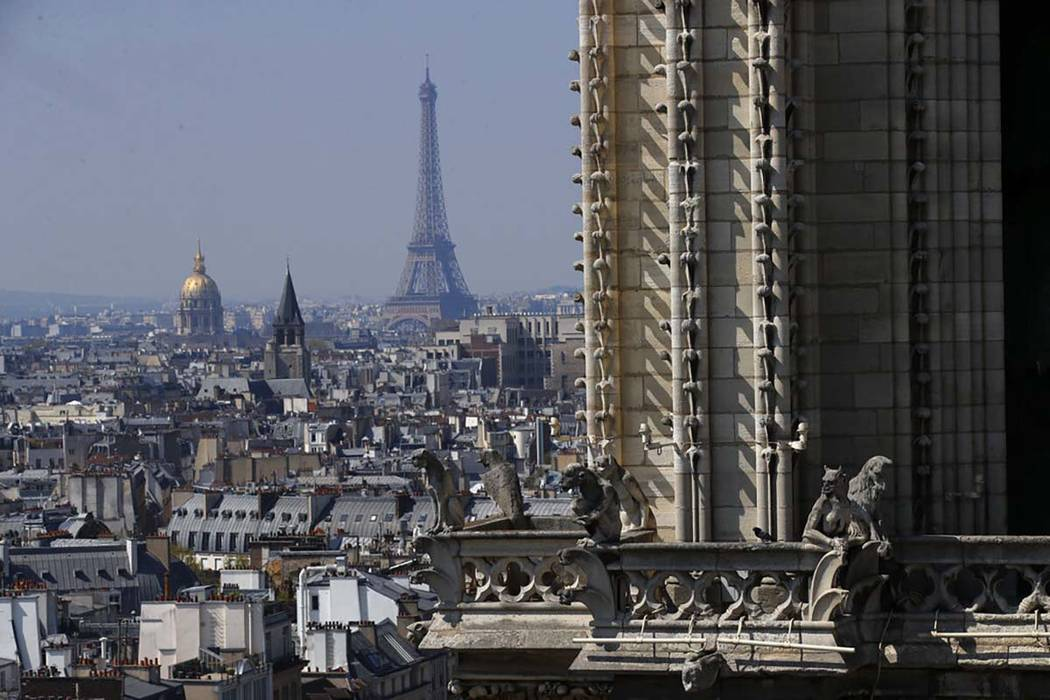 View from the top of the Paris' Notre Dame Cathedral with the Eiffel Tower in background as the ...