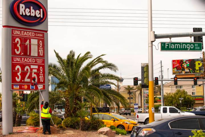 Rebel gas station asst. manager Michael Nunez puts up new gas prices at their station on E. Fla ...