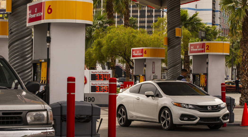 Patrons pump gas at the Shell station on E. Flamingo Road at Koval Lane as gasoline prices jump ...
