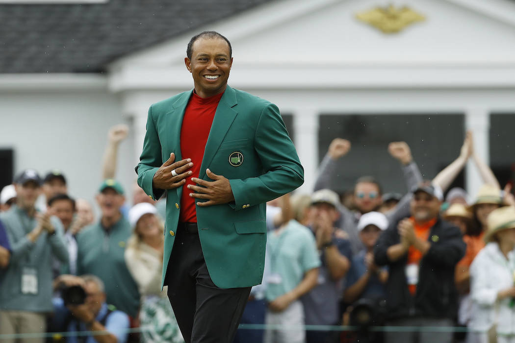 Tiger Woods Smiles As He Wears His Green Jacket After Winning The Masters Golf Tournament Sunda