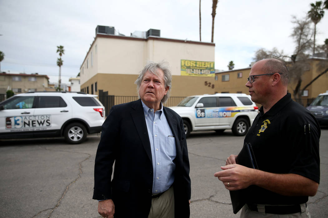 Clark County Commissioner Tick Segerblom, left, and Chief of Code Enforcement Jim Andersen chec ...