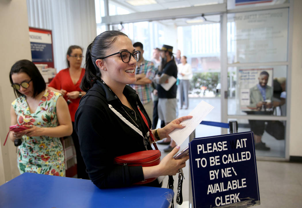 Drea Hopper, 35, of Las Vegas, waits to mail her taxes at the Downtown Las Vegas Post Office Mo ...