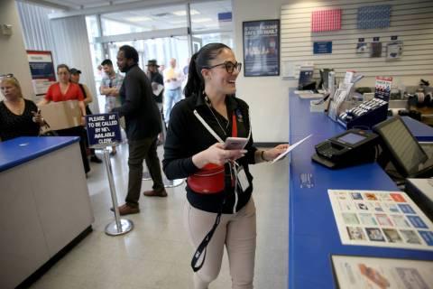 Drea Hopper, 35, of Las Vegas, mails her taxes at the Downtown Las Vegas Post Office Monday, Ap ...