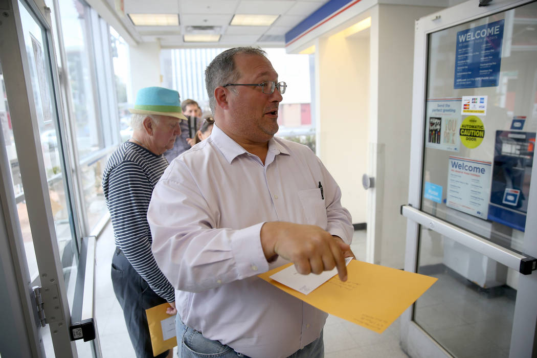 Jeffrey Balcom, 44, of Las Vegas, waits to mail his taxes at the Downtown Las Vegas Post Office ...