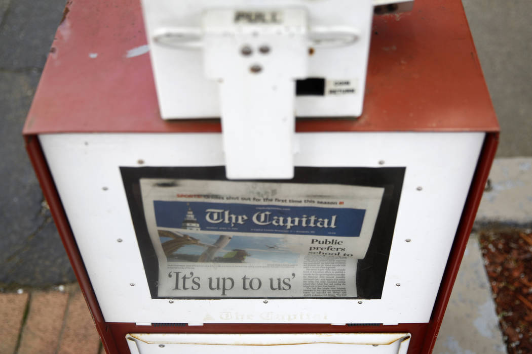 A copy of the day's Capital Gazette newspaper rests in a newsstand, Monday, April 15, 2019, in ...