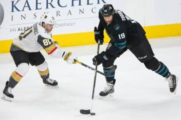Vegas Golden Knights center Jonathan Marchessault (81) defends against San Jose Sharks center J ...
