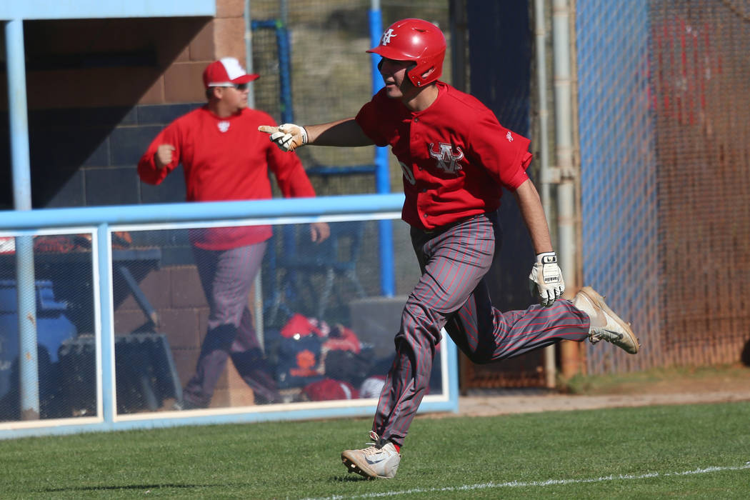 Arbow View's Dillon Jones (10) runs home for a run against Carson in the baseball game at Cente ...