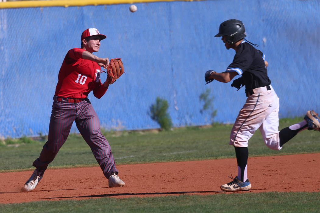 Arbow View's Dillon Jones (10) throws to second base for a double out play against Carson in th ...