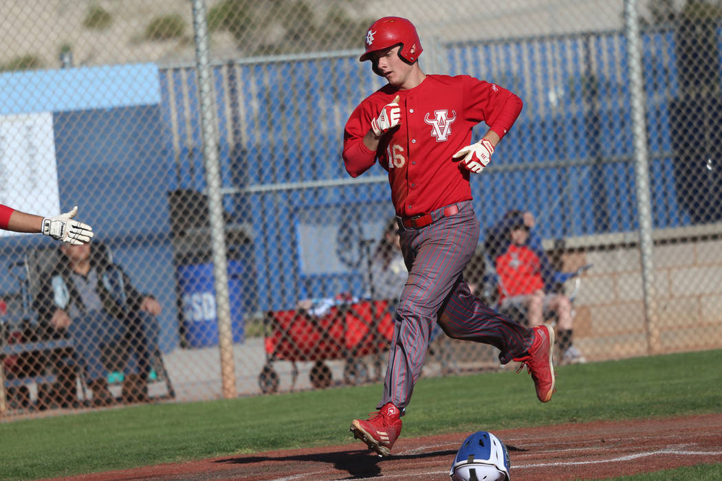 Arbor View's Jacob Scioli (16) runs home for a run against Carson in the baseball game at Cente ...