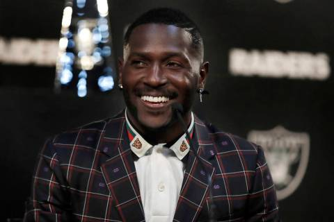 Raiders wide receiver Antonio Brown smiles during the NFL football team's news conference Wedne ...