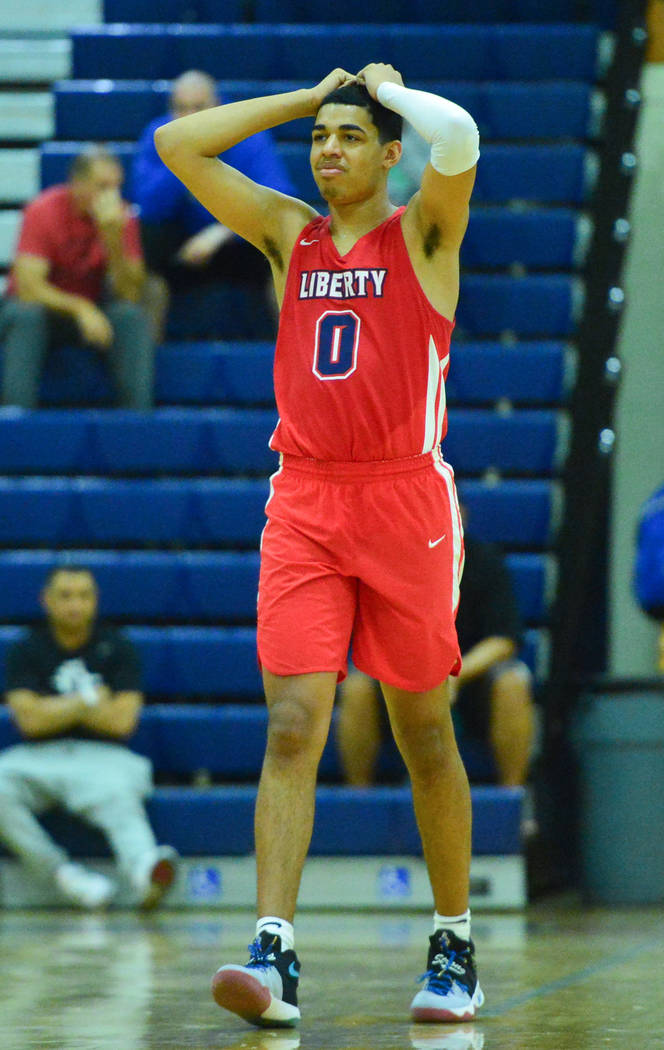 Liberty's Julian Strawther (0) reacts to a foul call in the fourth quarter of a game between Li ...