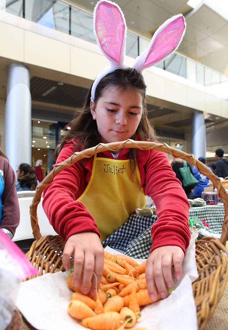 Newton Elementary School student Juliet Robertson, 10, displays baby carrots at Green Our Plane ...