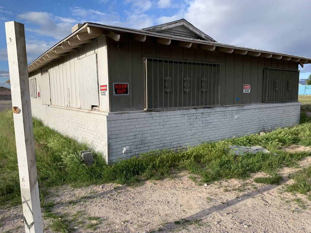 Pictured is the abandoned building that sits at the corner of Simmons Street and Coran Lane. Br ...