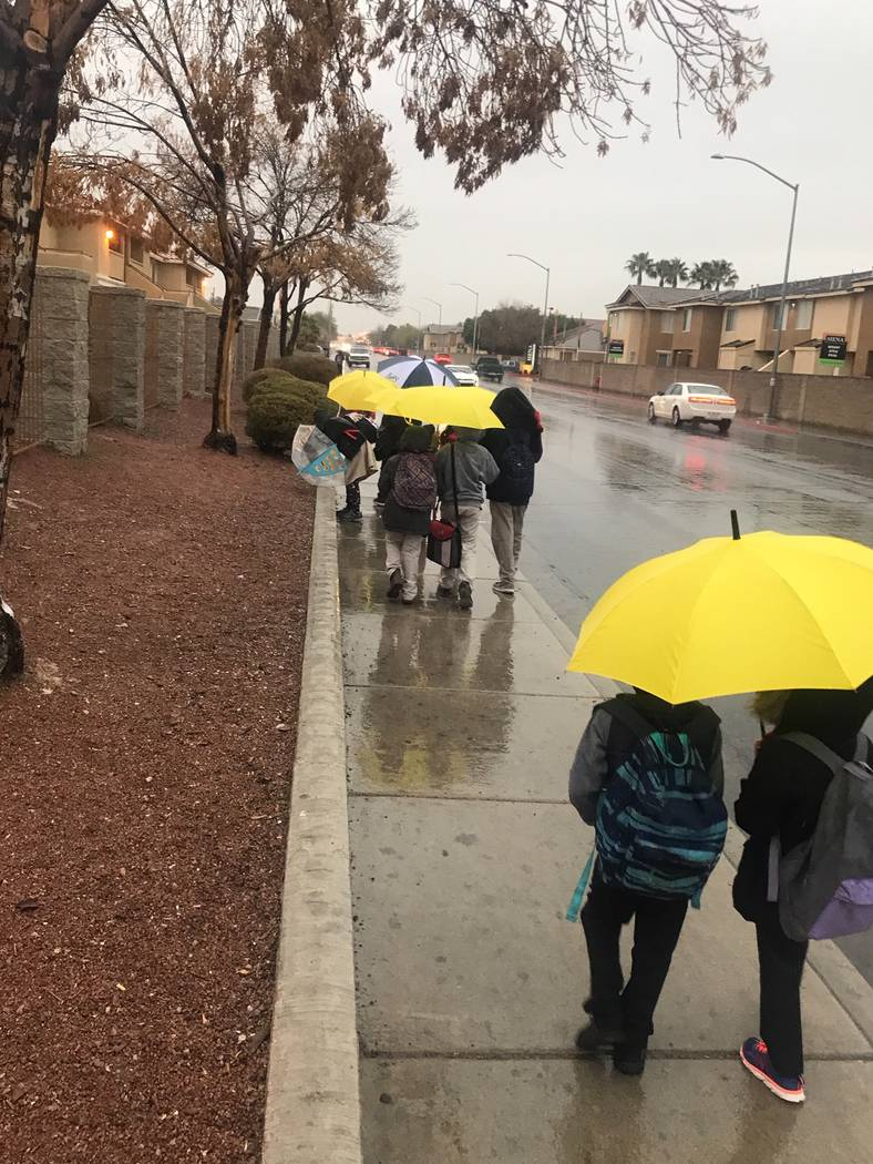 Students walk to school rain, sleet, or snow, Brassard said. Mentors give students umbrellas to ...