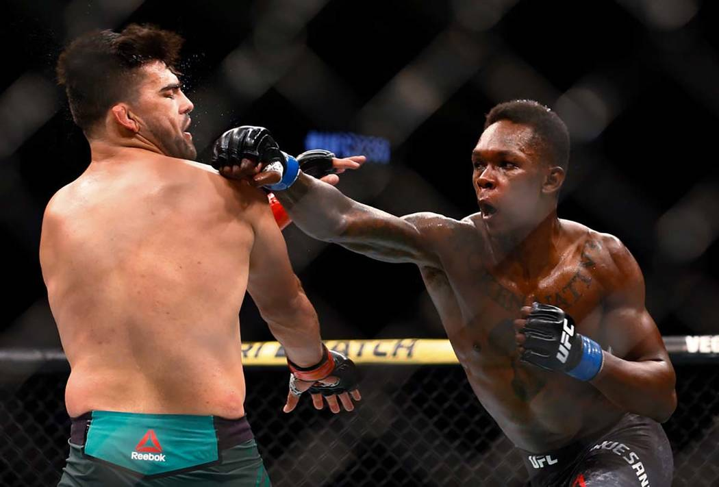 Kelvin Gastelum avoids a punch from Israel Adesanya fight during a middleweight mixed martial a ...