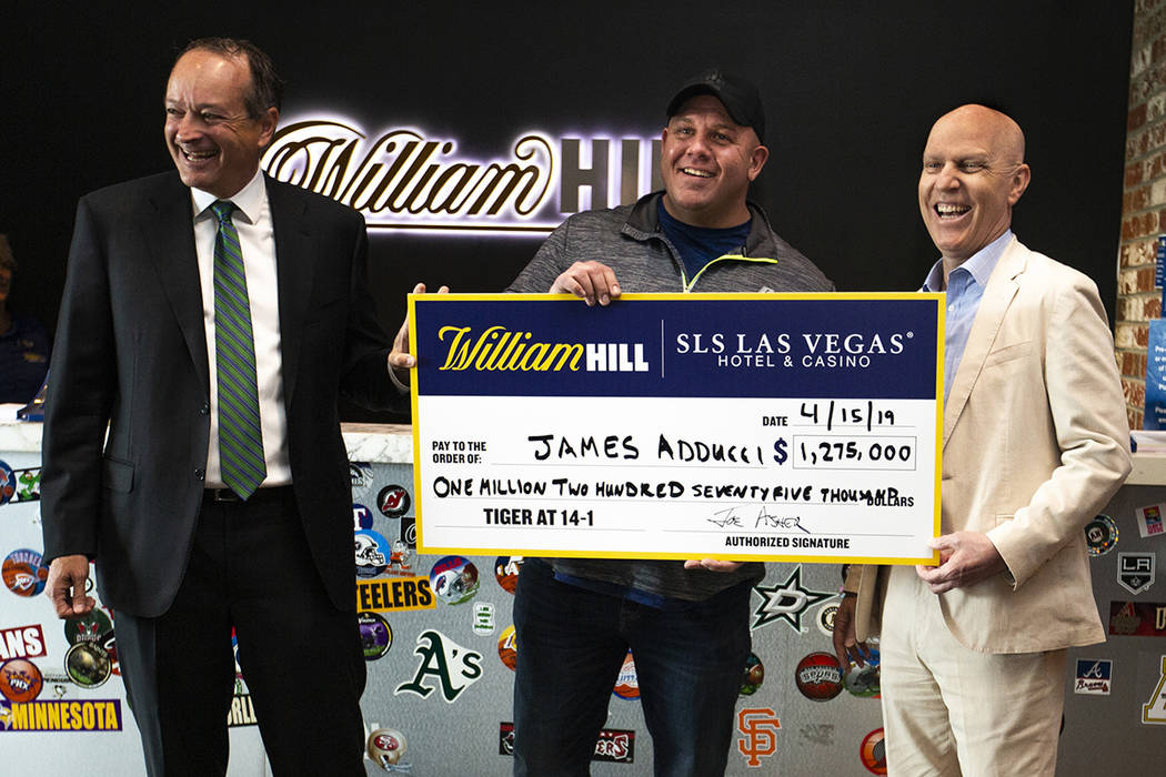 William Hill CEO Joe Asher, stands with big winner James Adducci of Wisconsin and SLS General M ...