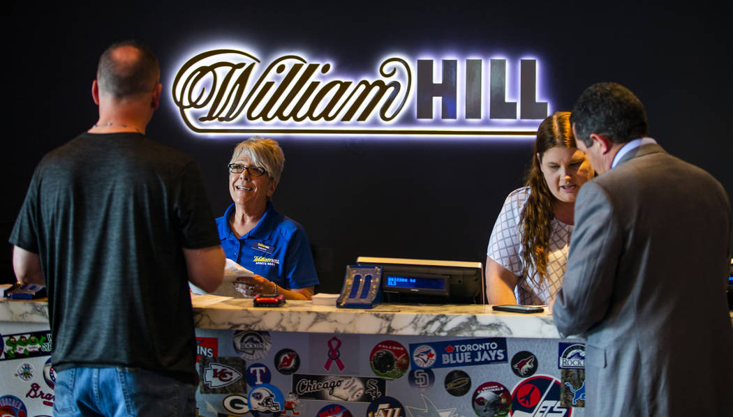 Customers place their wagers at the William Hill Sports Book at the SLS on Monday, April 15, 20 ...
