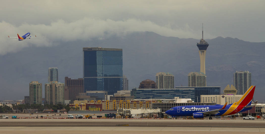 Planes takeoff and taxi at McCarran International Airport on Tuesday, April 16, 2019, in Las Ve ...
