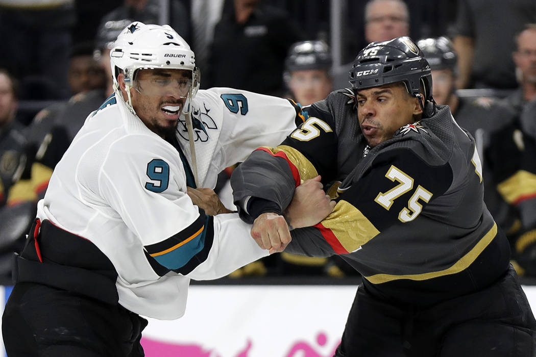Vegas Golden Knights right wing Ryan Reaves (75) and San Jose Sharks left wing Evander Kane (9) ...