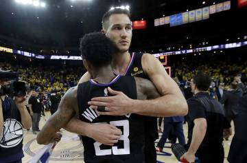 Los Angeles Clippers guard Lou Williams, left, and forward Danilo Gallinari celebrate after def ...
