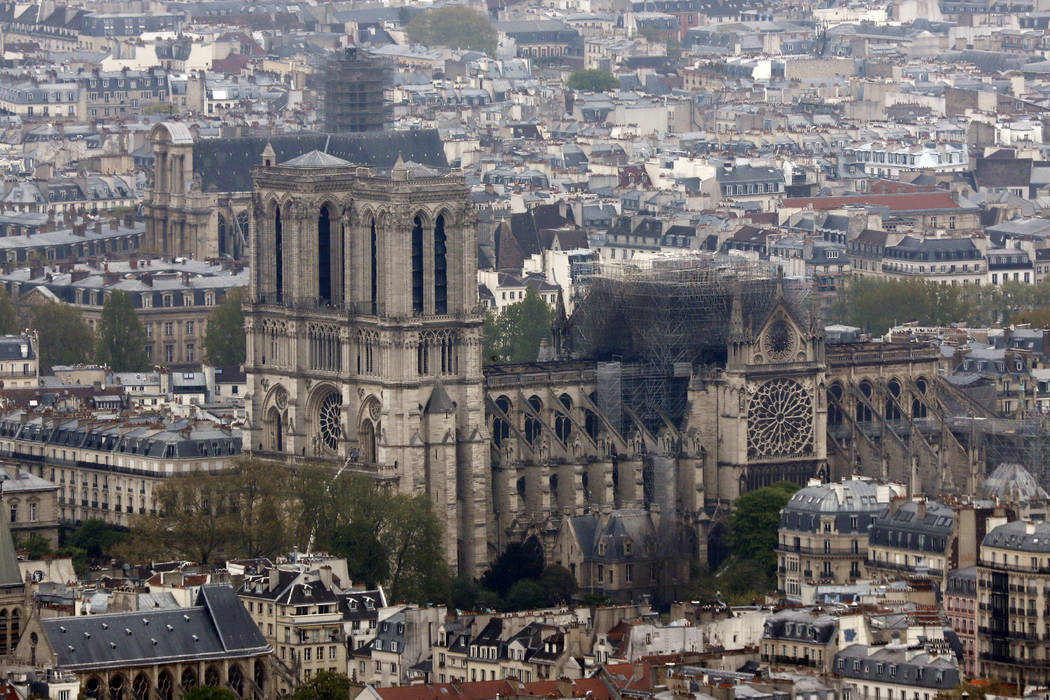 Notre Dame cathedral is pictured from the top of the Montparnasse tower, Tuesday April 16, 2019 ...