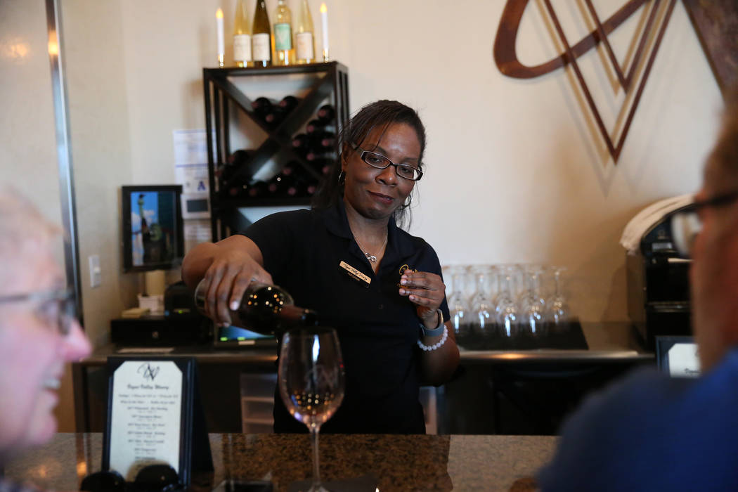 Winetender Regina Johnson pours a glass of wine for a customer at Vegas Valley Winery in Hender ...