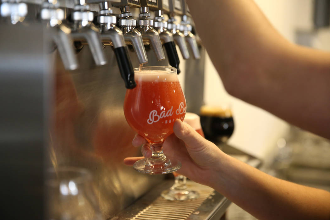 Office manager Amber Barkley pours a beer for a customer at Bad Beat Brewing in Henderson, Satu ...