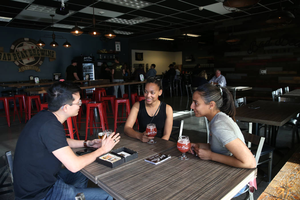 Steven Young, from left, Alaina Geary, and Jessica Pharar, at Bad Beat Brewing in Henderson, Sa ...