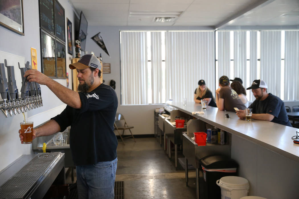 Allan Harrison, head brewer at Astronomy Ale Works, pours a glass of beer at Astronomy Ale Work ...