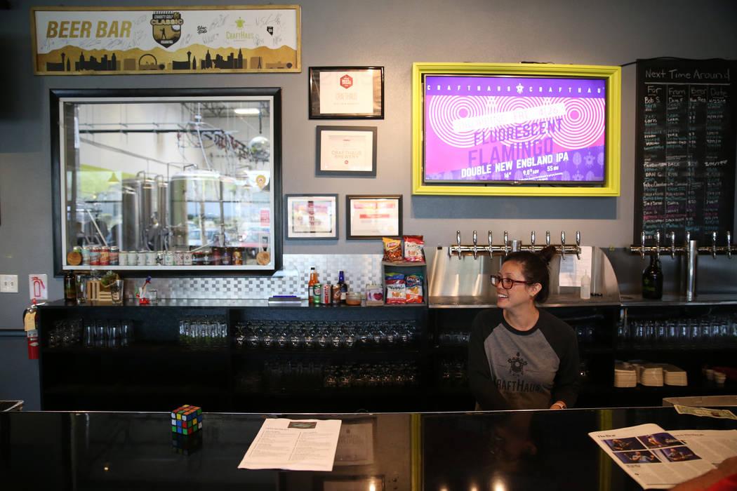 Beertender cleans glasses at CraftHaus Brewery in Henderson, Saturday, April 13, 2019. (Erik Ve ...