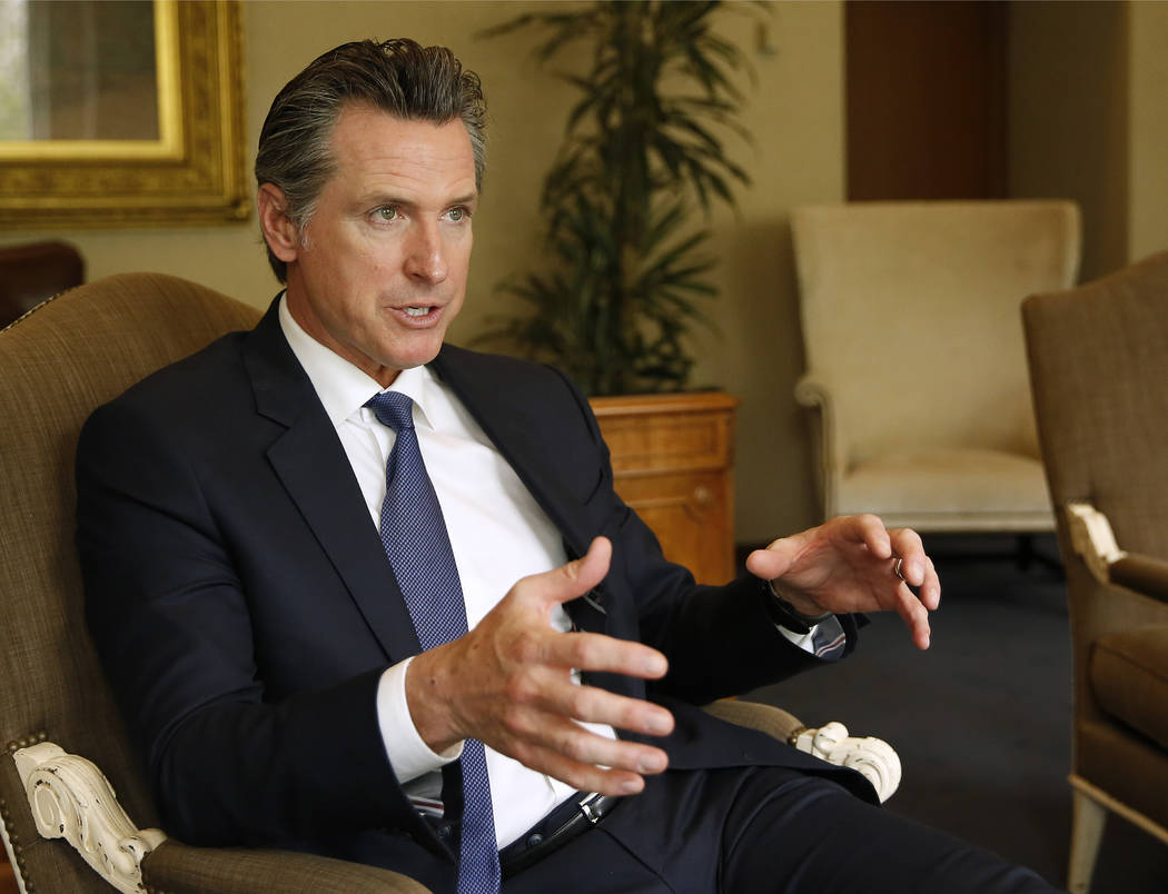 Gov. Gavin Newsom speaks during an interview with The Associated Press, Monday, April 15, 2019, ...