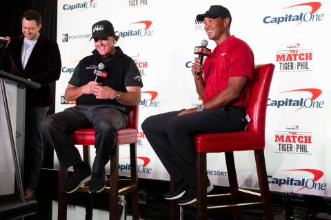 Phil Mickelson, second left, and Tiger Woods take questions during a press conference at Shadow ...