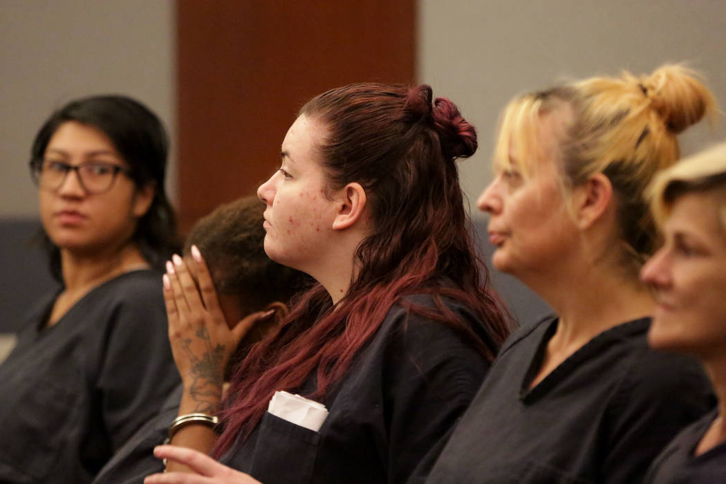 Diana Pena, center, one of three suspects in the killing of a California doctor appears in cour ...