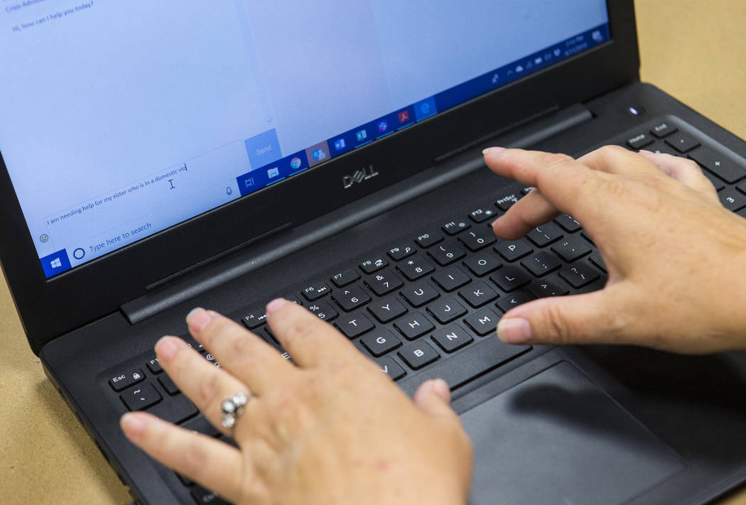 Jodi Pudwill, manager of the SafeNest hotline, demonstrates the online chat features that were ...