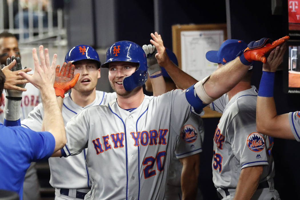 New York Mets' Pete Alonso (20) celebrates after hitting a two-run home run during the seventh ...